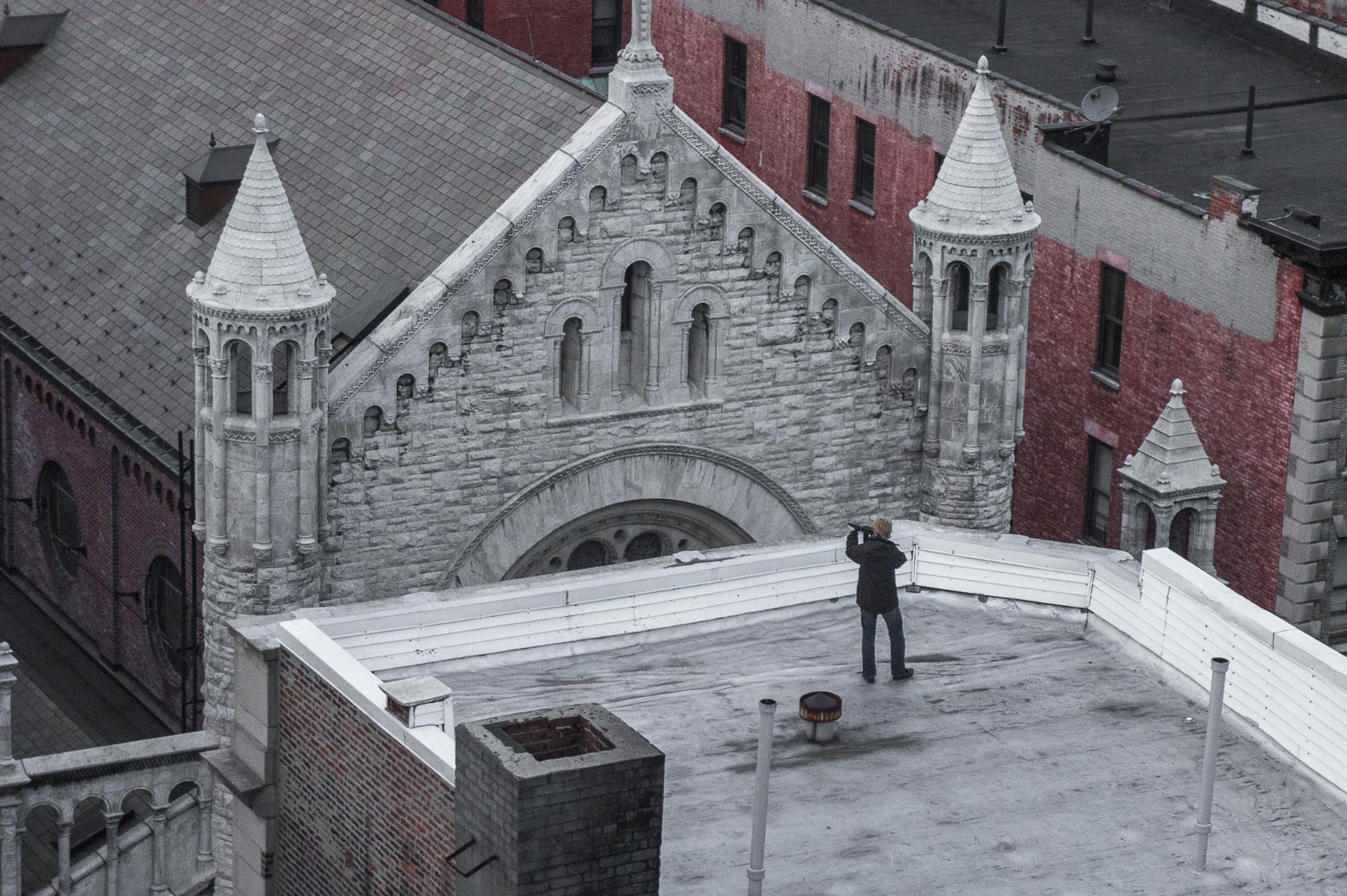 Teen with Toy Gun on Roof